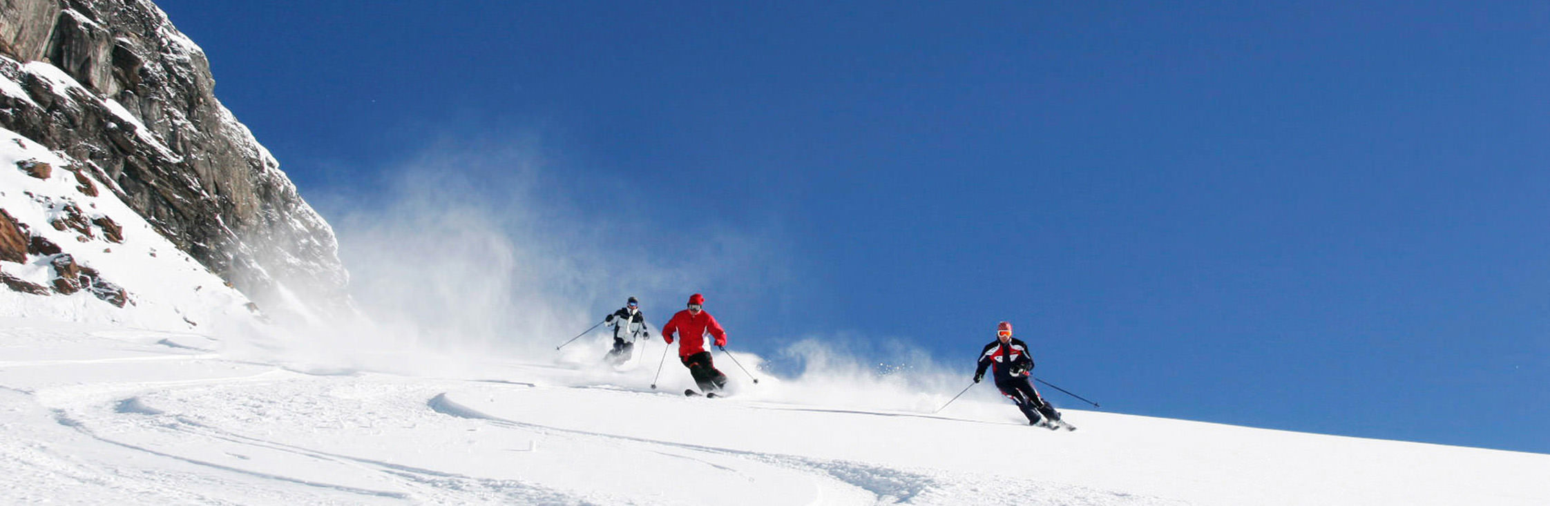 heliskiing_small_tracks-in-snow-skier