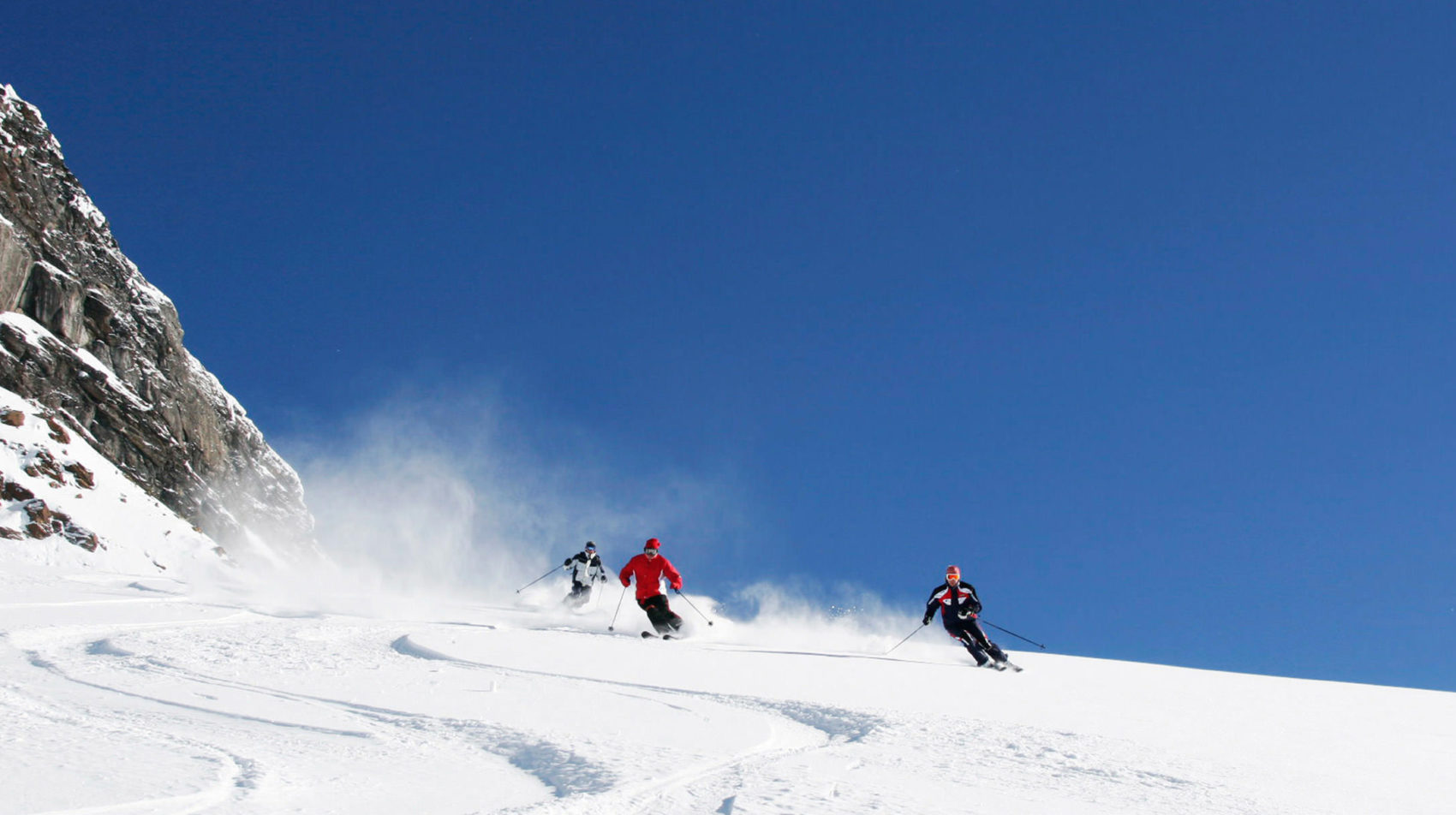 heliskiing_tracks-in-snow-skier